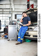 Mechanic Talking on Phone