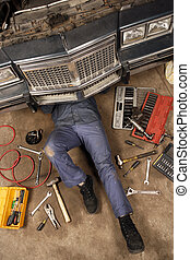 Mechanic under the car