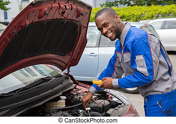 Mechanic Using Multimeter To Check Car Battery