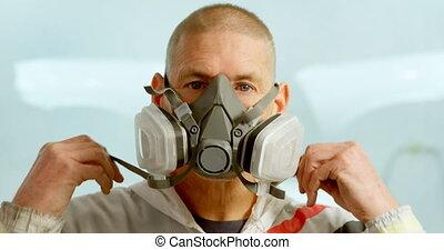 Mechanic wearing gas mask 4k