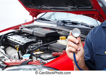 Auto repair - Mechanic with a stethoscope. Auto repair shop.