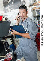 mechanic with cellphone