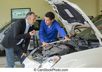 mechanic with client at auto service
