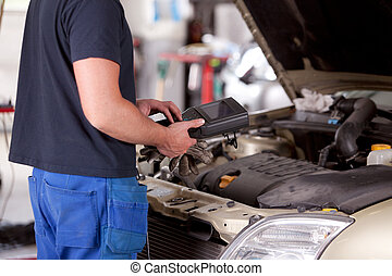 Mechanic with Diagnostic Equipment - Detail of a mechanic ...