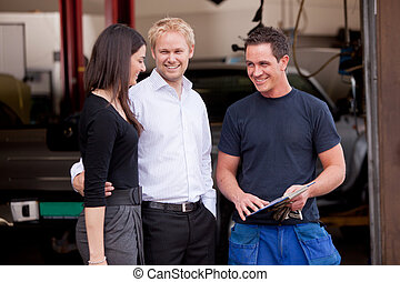 Mechanic with satisfied Customer