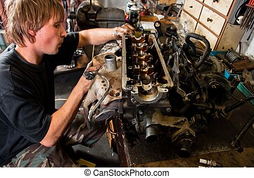 Mechanic worker inspecting car interiors