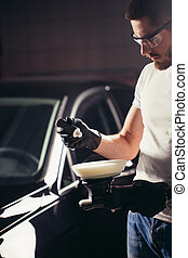 mechanic worker prepare for polishing car by power buffer machine