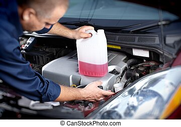 Mechanic working in auto repair garage