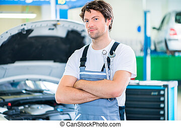Mechanic working in car workshop