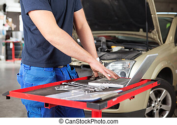 Mechanic working on a laptop