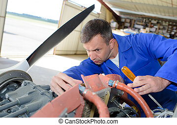 Mechanic working on aircraft