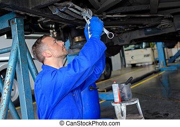 Mechanic working underneath a car