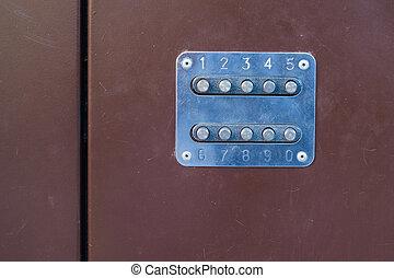 mechanical combination lock on the iron door, colored metal door
