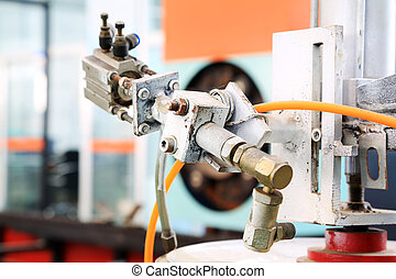 mechanical device in the production line in a factory, closeup of photo