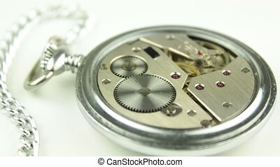 Mechanical pocket watch on white background
