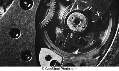 Mechanical watch movement - Black and white macro shot of...