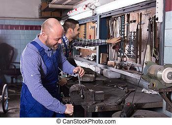 Mechanics at work in repair shop