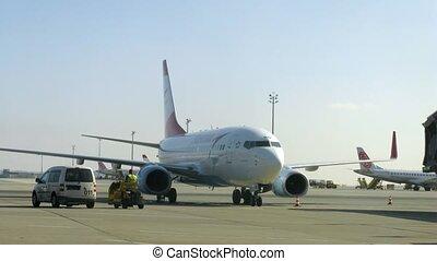 Mechanics board do maintenance inspection of plane and move...