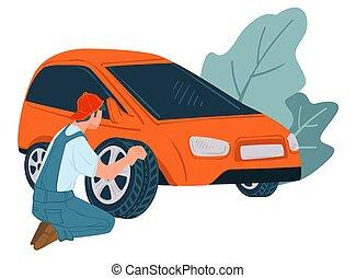 Mechanics changing old car tyre, shop or service - Mechanics...