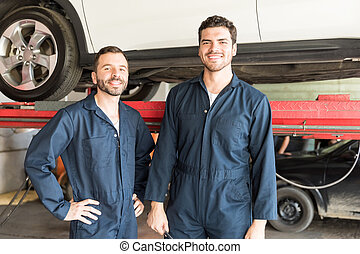 Mechanics Smiling In Auto Repair Shop