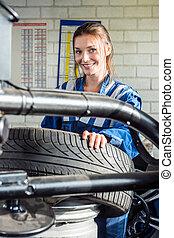 Mechanics Using Digital Tablet In Car At Garage