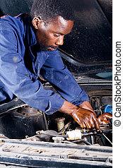 mechanik, afrykanin