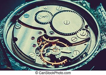 mechanism antique vintage wrist watch beautiful original dark metallic background in the  technique of blue toning