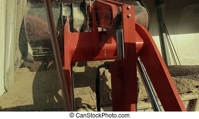 Mechanism of bucket of tractor is observed here. There is a machinery in it is well so it works like a machine and it requires fuel and engine to operate.