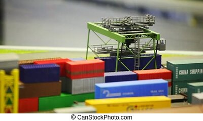 mechanism of moving toy mobile cargo loader on railway among containers