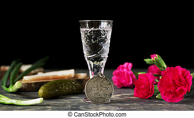 Medal of valor, red carnations and glass of vodka, isolated...