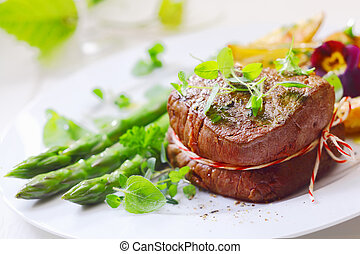 Medallion of roast fillet steak tied with string and served...