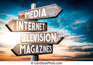 Media, internet, television, magazines - wooden signpost, roadsign with four arrows