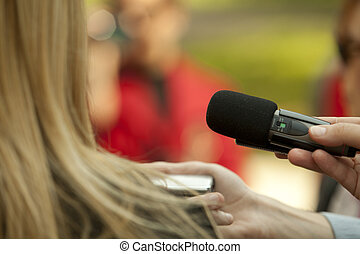 media interview - Journalist hand holding a microphone...