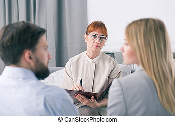 Mediator talking to a couple during a session