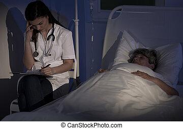 Medic diagnosing elderly woman