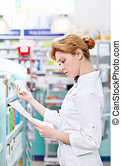 Medical - A young girl at the pharmacy