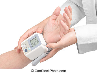 Doctor measuring the pressure in an elderly patient with a blood pressure digital monitor.