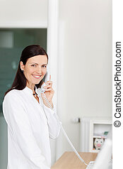 Medical assistant on phone
