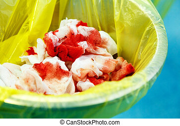 Medical bloody waste in trash bin. Surgery and emergency concept