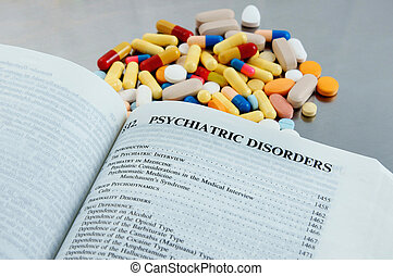 Close-up of a medical diagnosis book with prescription medication