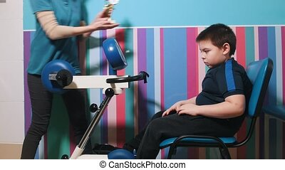 Medical clinic. An occupation with child with cerebral...