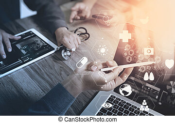 Medical co working concept, Doctor working with smart phone and digital tablet and laptop computer to meeting his team in modern office at hospital