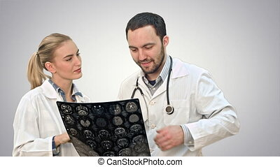 Medical collaboration examine xray and discuss patient problems on white background.