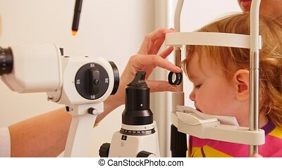 Medical concept - child's ophthalmology - doctor optometrist...