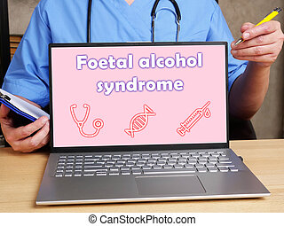 Medical concept meaning Foetal alcohol syndrome with inscription on the piece of paper.