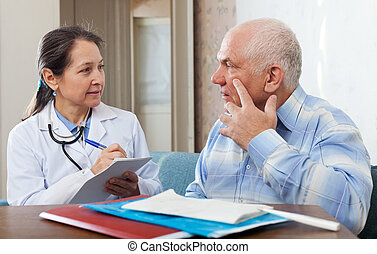 Medical consultation. Senior patient and doctor talking at ...
