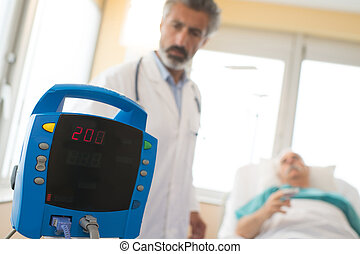 medical device doctor and patient in the recovery room