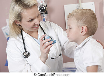 Medical doctor applying oxygen treatment on a little boy...
