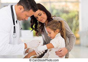medical doctor bandaging patient
