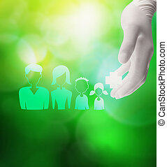 medical doctor hand holding icon of happy family with medical ca